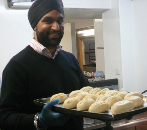 Volunteer at St George's Crypt with freshly cooked bread